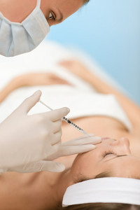 Woman in cosmetic medicine treatment getting botox injection,close-up portrait