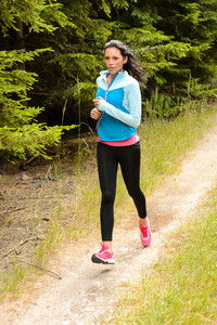Woman jogging outdoor running on countryside path