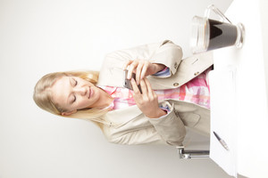 Woman looking at phone and working