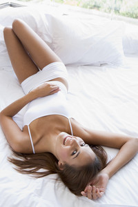 Woman lying in bed smiling