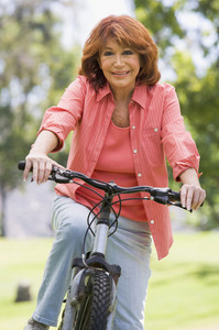 Woman on bike outdoors smiling