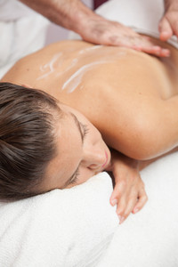 Woman receiving a massage at the spa