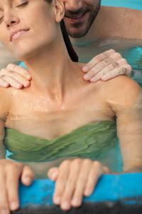 Woman receibing a massage inside the pool