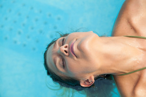 Woman relaxed inside the pool