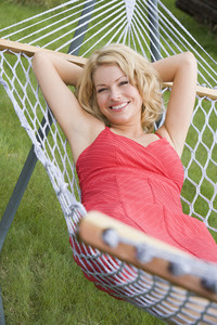 Woman relaxing in hammock smiling