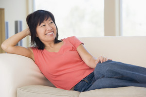 Woman relaxing in living room smiling