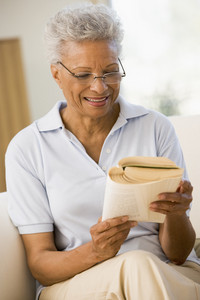 Woman relaxing with a book and smiling