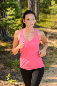 Woman running in the countryside training with headphones