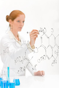 Woman scientist in laboratory write chemical formula with test bue and beaker