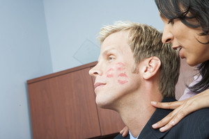 Woman seducing man in office
