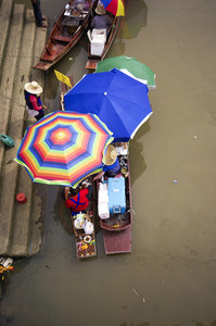 Woman selling foods on a floating market in Thailand - Ampawa Floating Market, neer bangok