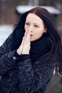Woman Shivering in the Frozen Outdoors