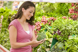 Woman shopping in produce section of supermarket