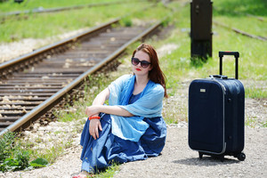 Woman siting and waiting for train