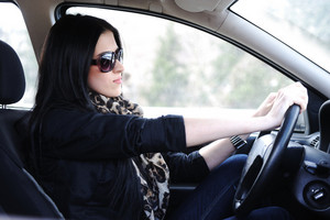 Woman Sitting In Car And Driving