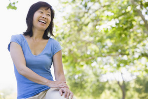 Woman sitting outdoors smiling