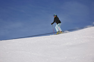Woman skiing on fresh snow at winter season