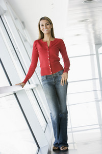 Woman standing in corridor smiling