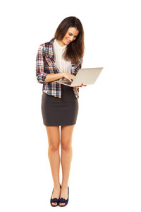 Woman standing while browing the internet using her laptop