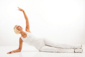 Woman stretching her arm  fitness yoga exercise workout white background