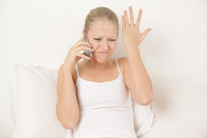 Woman talking by phone and angry