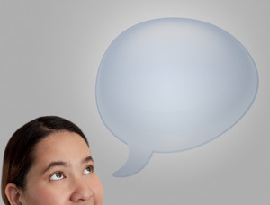 Woman Thinking In Blue Blank Speech Bubble On Grey Background.