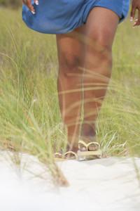 Woman walking at the beach