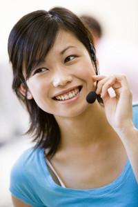Woman wearing headset indoors smiling