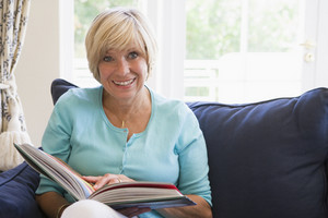 Woman with a book smiling
