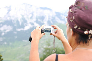 Woman with camera in mountains