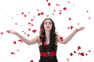 Woman with falling rose petals