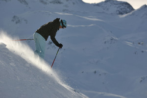 Womanskiing on fresh snow at winter season