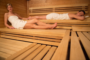 Women relaxing on wooden benches in sauna