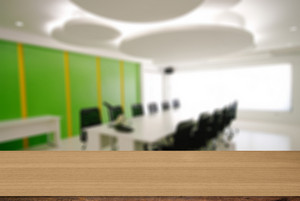 Wood desk decoration with Office Working Area background