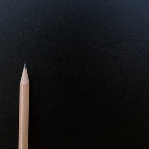 Wood pencil on blank blackboard