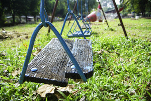 Wood swing on kid garden