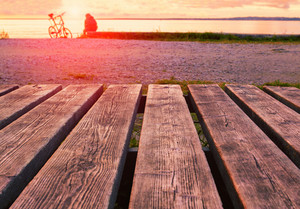 Wooden boards on the beach st sunset. Selective color