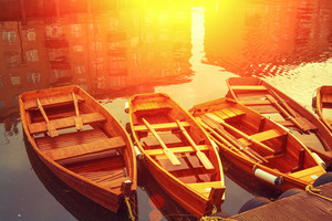 Wooden boats on the canal. Buildings reflection