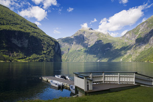 Wooden dock in a still mountain lake
