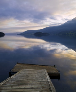 Wooden dock on a lake at sunset