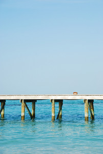 Wooden Jetty Bridge On A Beautiful Maldivian Beach
