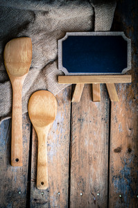 Wooden Kitchen Utensils And Board On Wood Background