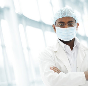 Working people with white uniforms in modern facility