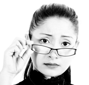 Worried And Intelligent Looking Woman Wearing Glasses