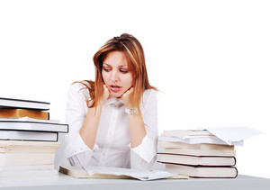 Worried attractive girl between lot of books