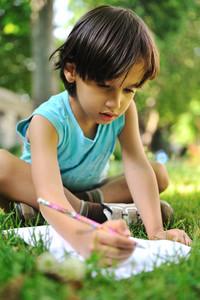 writing kid boy , outdoor