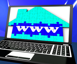Www On House On Laptop Showing Online Real Estates