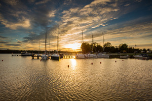 Yachtboats in ports at evening with beautiful sunset sky. Port in sztynord