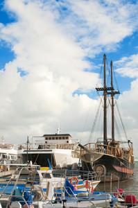Yachts And Fishing Boats At Pier