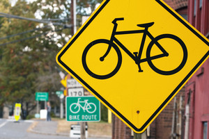 Yellow and green bike route road signs.